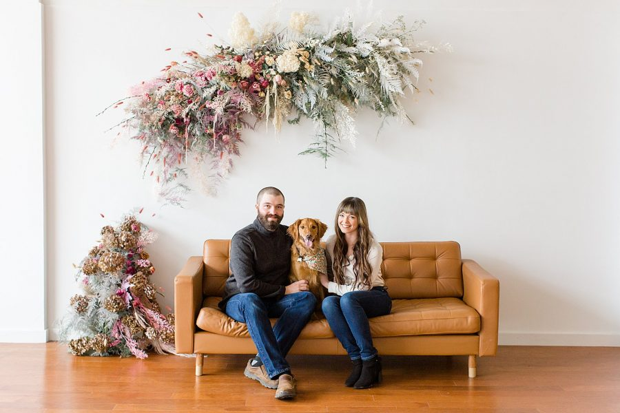 Couple's Session at The Gray Lab - couple sitting on couch with Golden Retriever