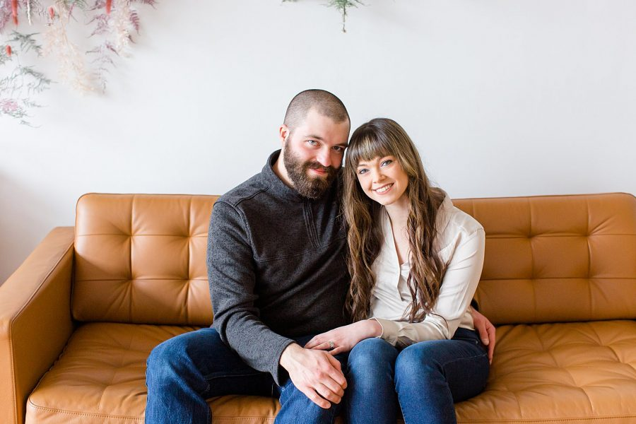 Couple's Session at The Gray Lab - husband and wife sitting on couch and smiling at camera