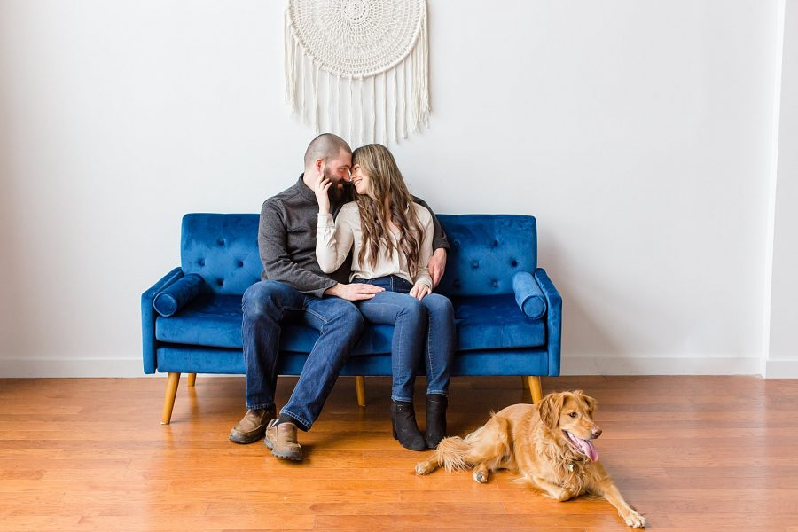 Couple's Session at The Gray Lab - couple sitting on couch snuggling with their dog sitting next to them on the floor